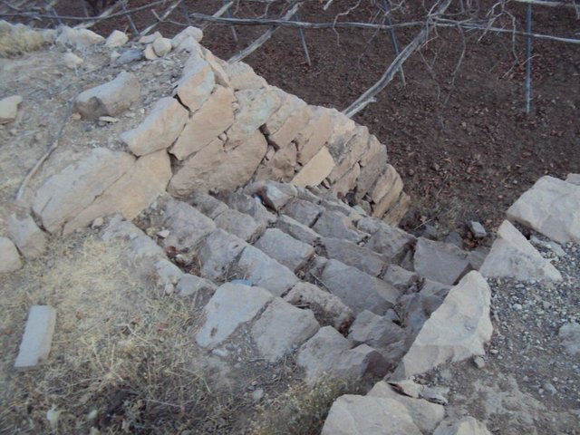 Building Walls's stones to protect lands and building outlet to drain excess water