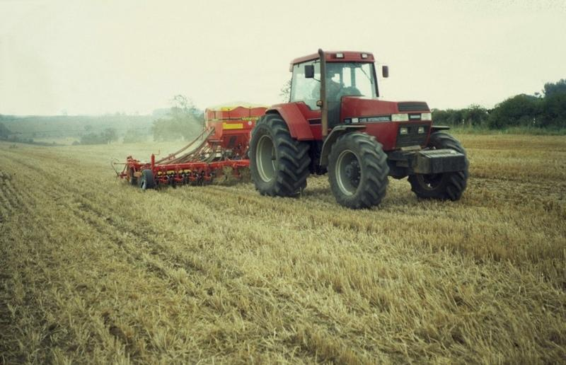 A tractor with the 'Väderstad Rapid Cultivation Drill' in action: a light surface tillage followed by direct seeding.