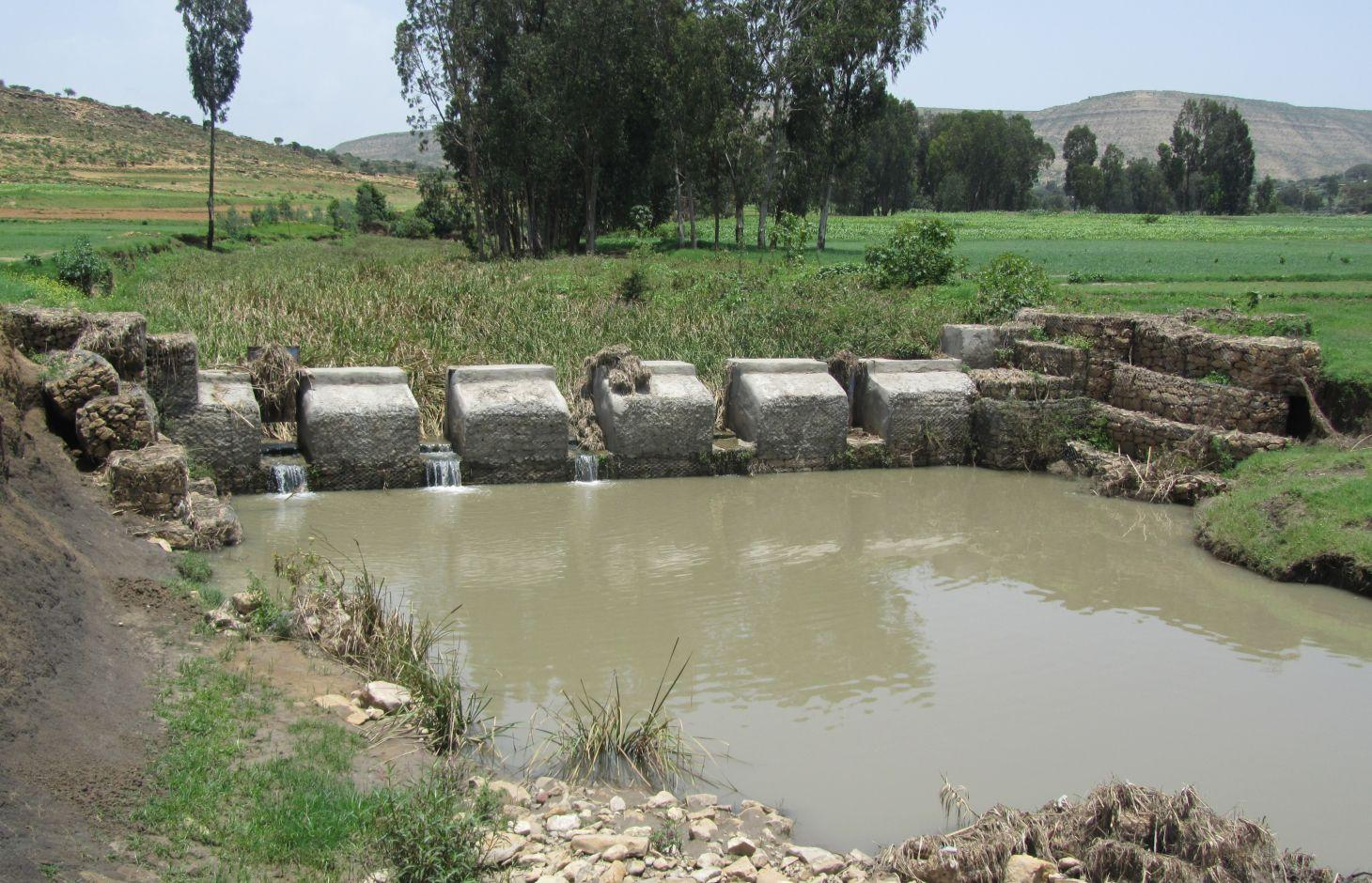 Checkdam with sluice gates removed during rainy season