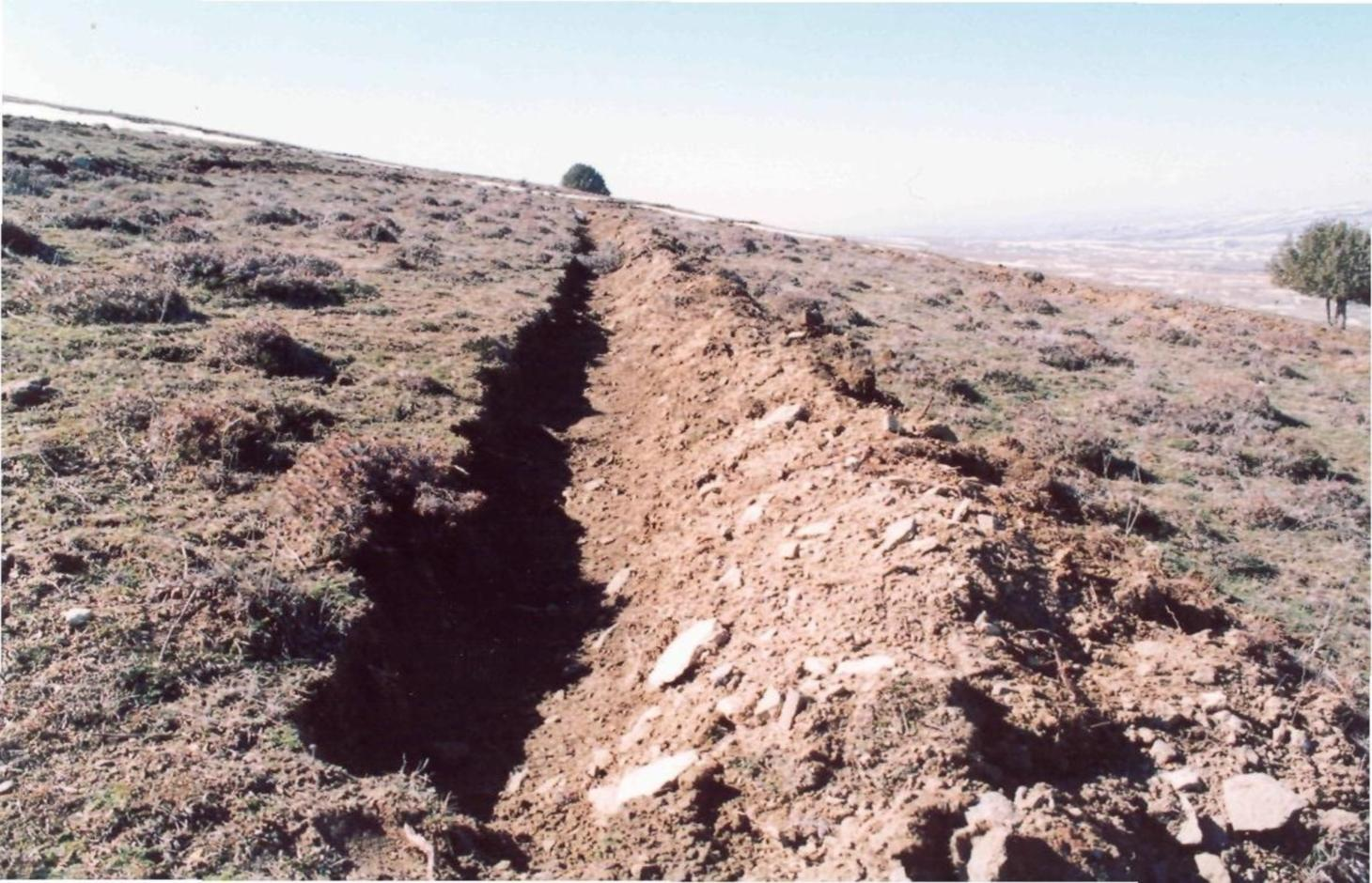 Cutting trenches on a slope