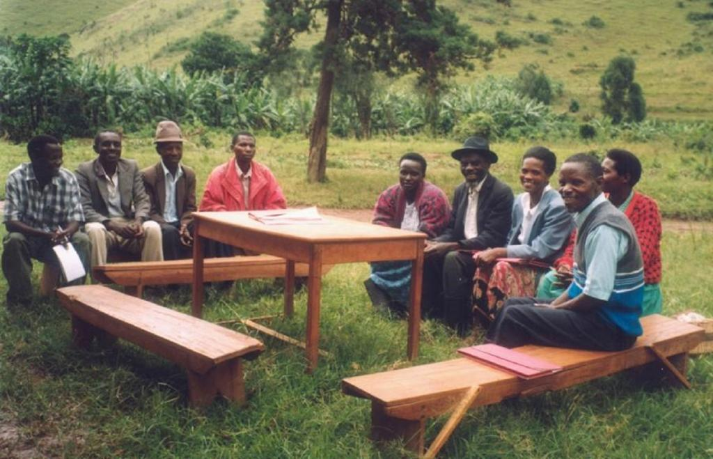 A cluster of innovators in Kabale District, Uganda, with the national coordinator, Alex Lwakuba (far left).