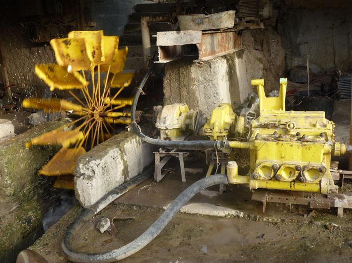 Photo shows the water wheel generating energy to power the water pump.  The pump can operate to vertical height of 200m.